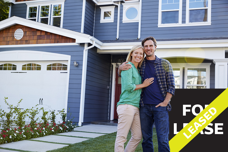 couple standing in front of their new rental property